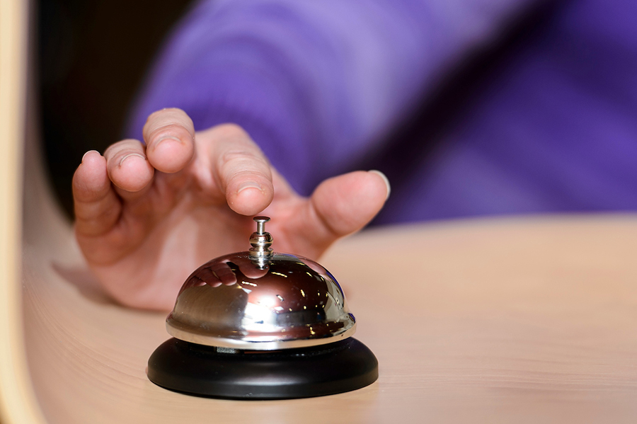 Person ringing a bell to start